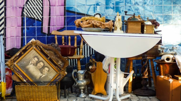 A bunch of used furniture and home decorations on display.