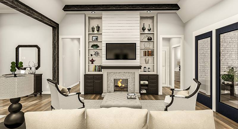 The living room has beige sectional, gray armchairs, tufted ottoman, and a fireplace with a TV on top.