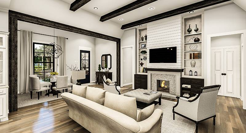 Beamed ceiling tops the living room while dark wood trims define the dining area on the side.