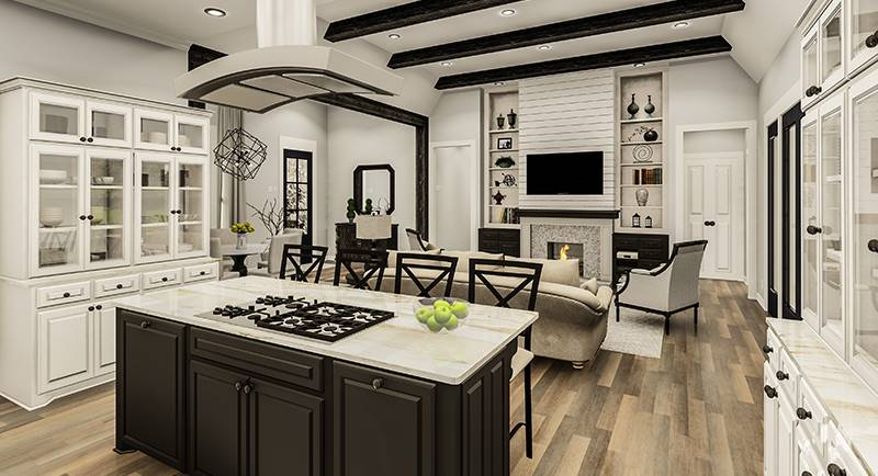 The center island is fitted with a built-in cooktop that's paired with a sleek vent hood.
