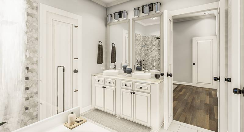His and her vanity with white cabinets, vessel sinks, and framed mirrors.