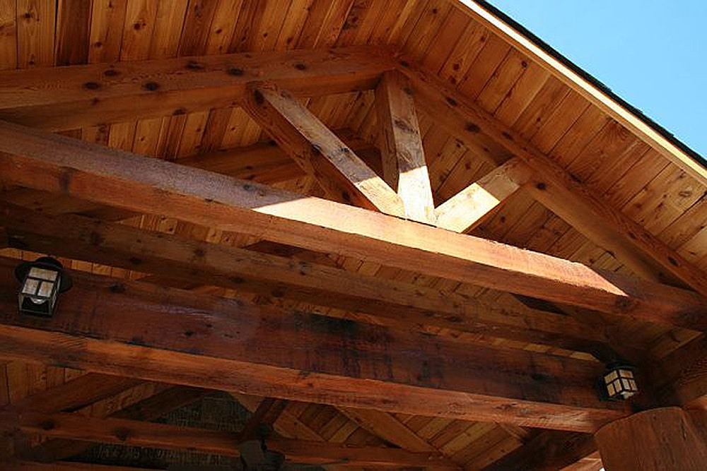 Closer look at the porch's cathedral ceiling with exposed wood beams.