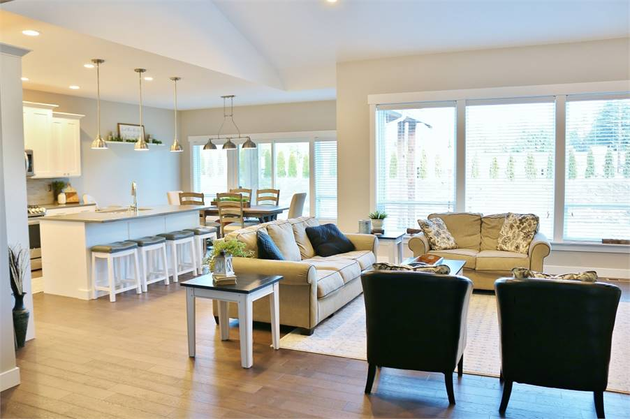 Massive windows and sliding doors on the right side bring in an ample amount of natural light.