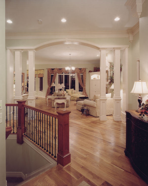 Entry hallway leading to the living room that's defined with interior columns.