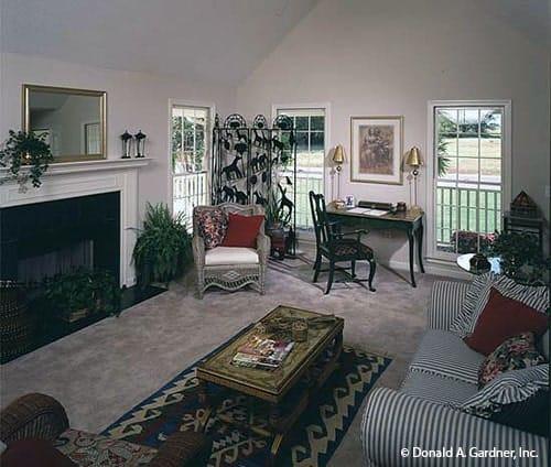 White framed windows on the side bring in an abundant amount of natural light.