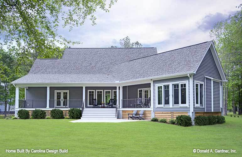 Rear exterior view showing the lap siding and raised covered porch complemented with a stoop.