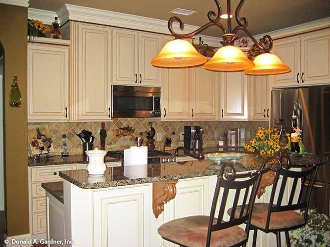 The kitchen is equipped with granite countertops, stainless steel appliances, and white cabinets.