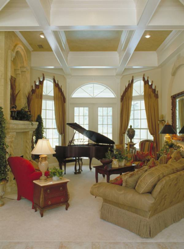 The living room has classic seats, a wooden coffee table, large arched windows, and a coffered ceiling.