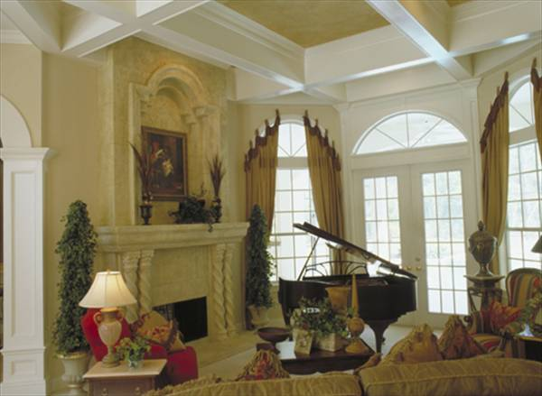 A marble fireplace fixed near the baby grand piano complete the living room.