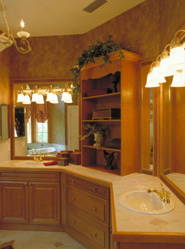 The primary bathroom features a dual sink vanity topped by a wooden shelving unit.