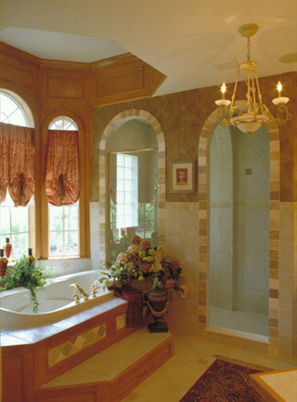 There's also a walk-in shower and a deep soaking tub fixed under the arched bay window.