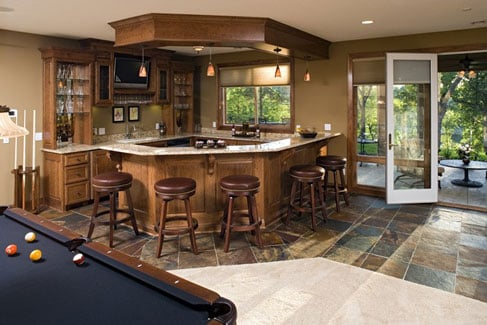 Billiards area with a wet bar and patio access.