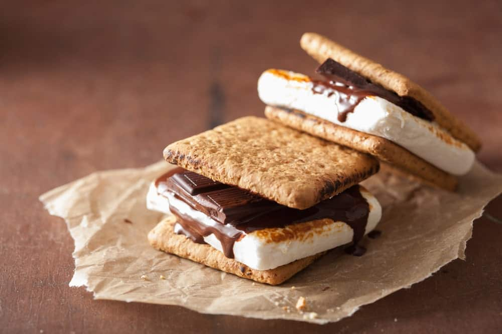 S'mores on a piece of paper against a wooden background.