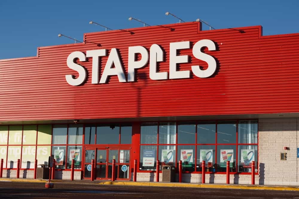 Staples retail outlet in North America with red and glass facade.
