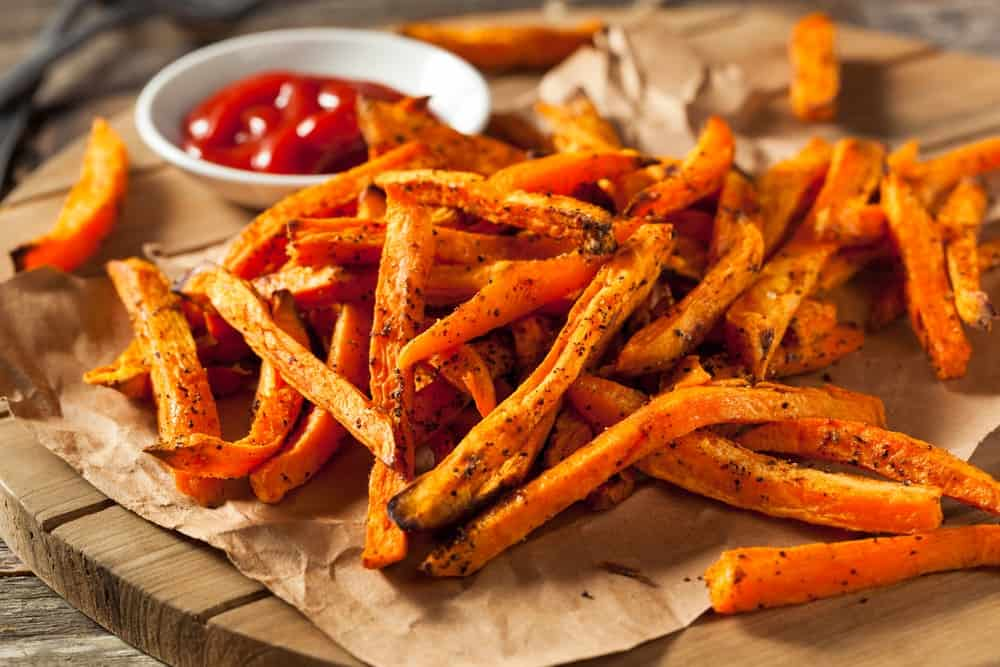 Sweet potato fries with ketchup on the side.