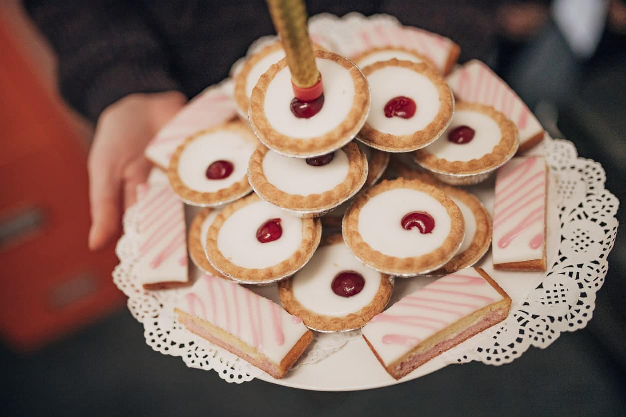 Tarts on a pyramid served on a plate.