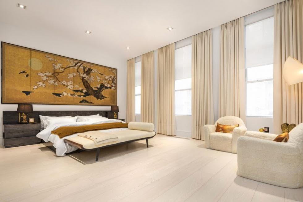 The bed is topped with a large oriental painting. These are then complemented by the row of windows on one side. Image courtesy of Toptenrealestatedeals.com.