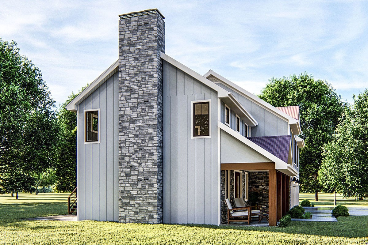 Left side view showing the stone brick chimney and a covered porch framed with wooden columns.