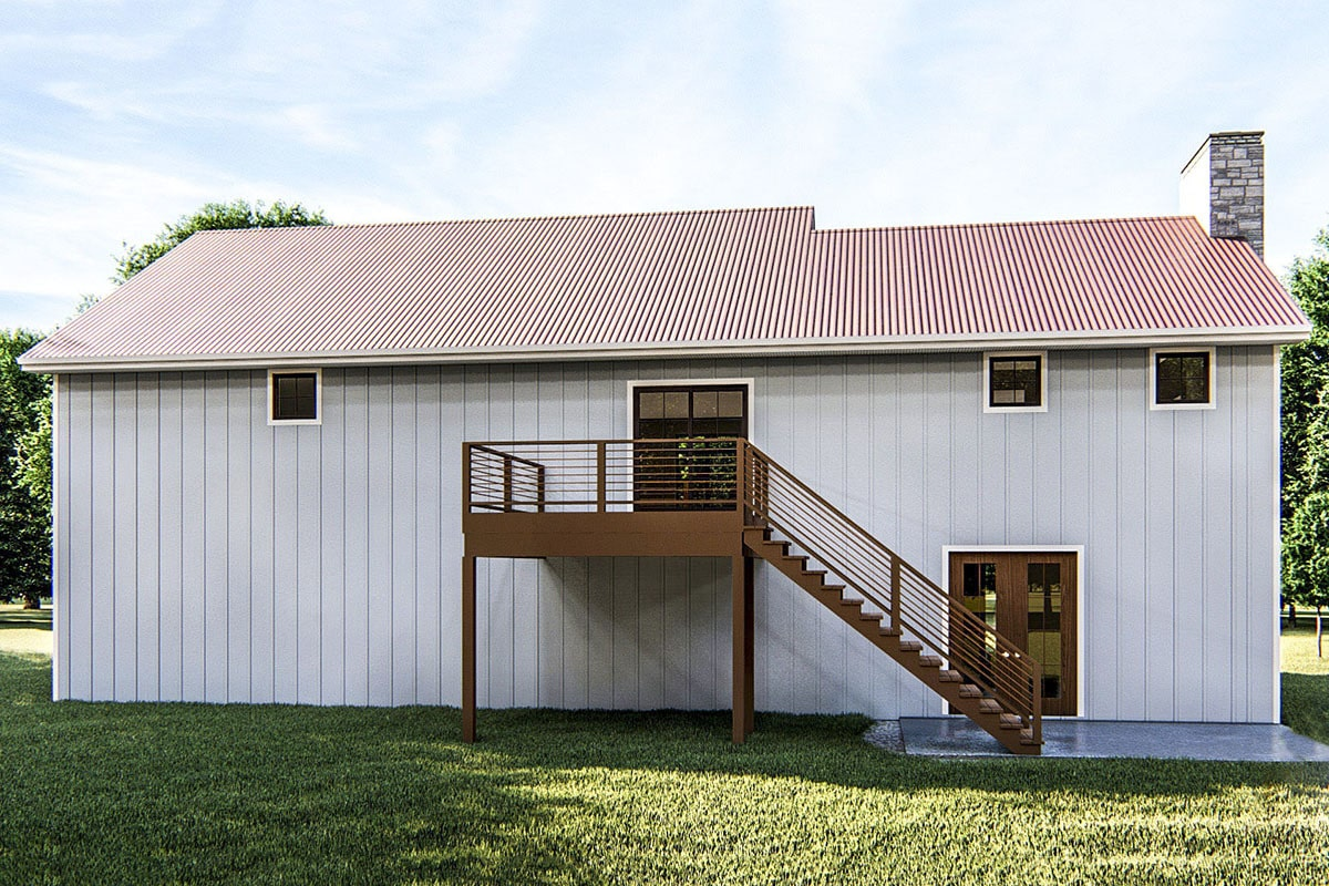 Rear exterior view with an upper deck and a french door that leads to the family room.
