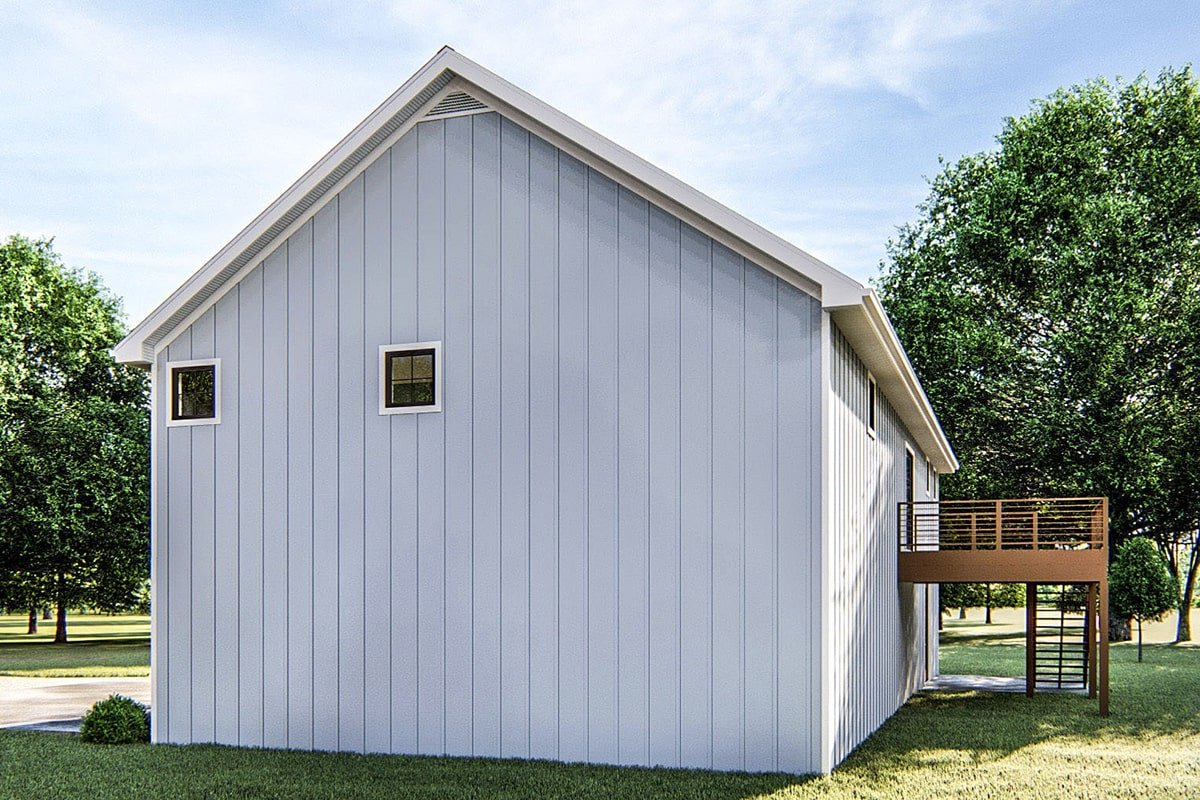 Right side view showing the gable roof, vertical lap siding, and small glass windows.