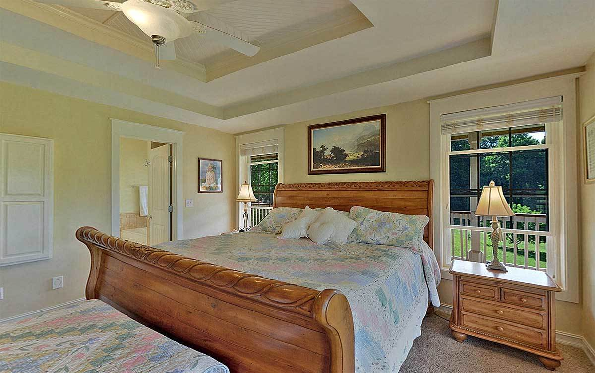 An ample amount of natural light streams in from the large windows of the primary bedroom.