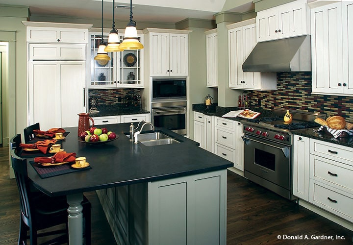 The center island is fitted with a double bowl sink and chrome fixtures.