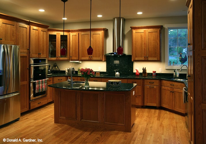 Small pendants along with recessed ceiling lights illuminate the kitchen.
