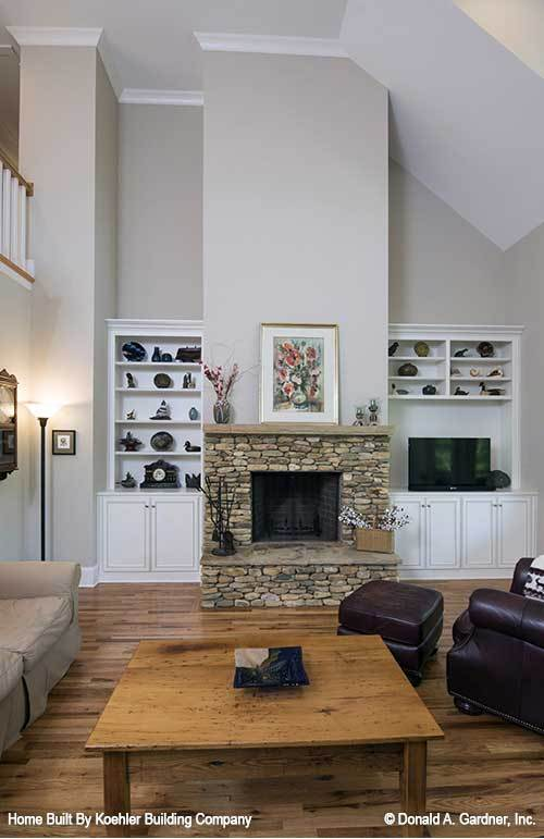White built-ins flanking the fireplace complete the living room.