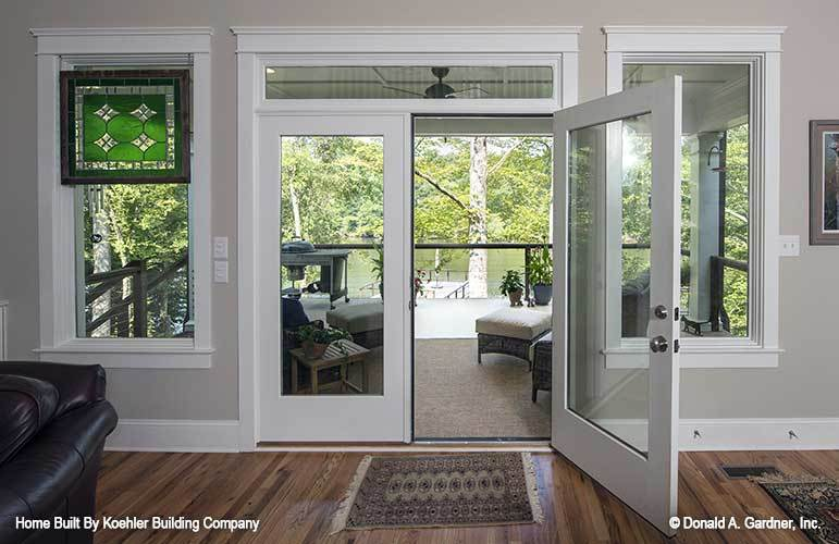 Glass doors in the living room open out to the rear porch.