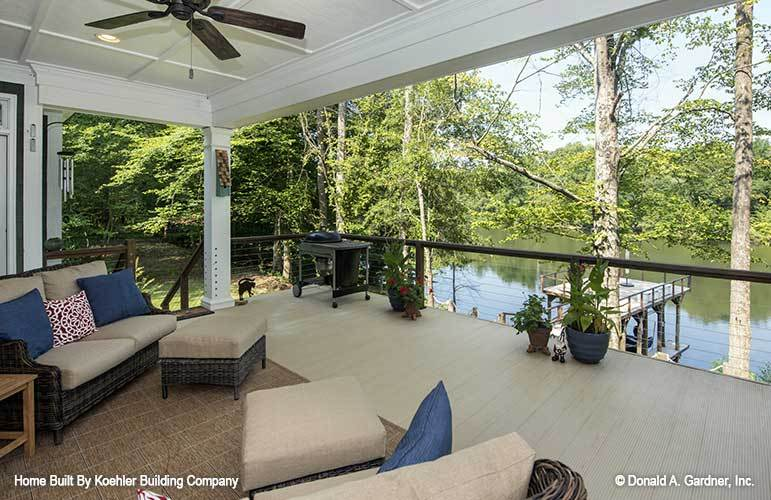 The rear porch has a magnificent view of the nearby lake.