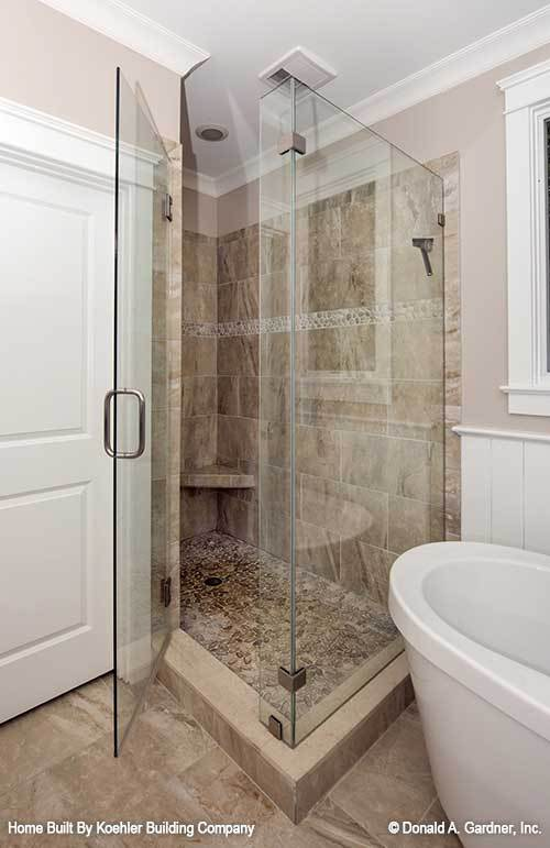Primary bathroom with a walk-in shower and a freestanding tub.