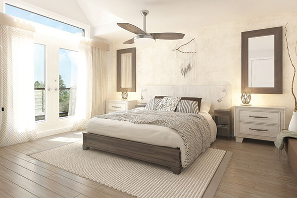 Primary bedroom with dark wood bed, ceiling fan, and white nightstands topped by framed mirrors.