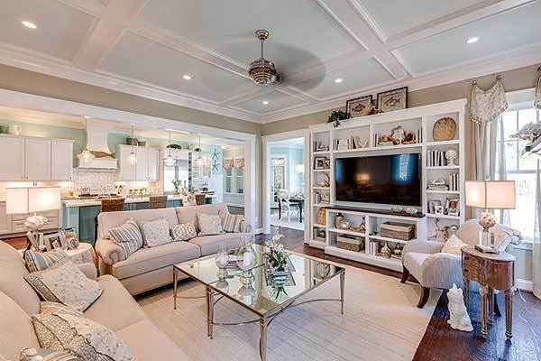 An open layout view showing the family room, kitchen, and breakfast room.