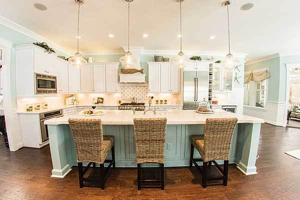 Wicker counter chairs along with glass pendants complement the center island.
