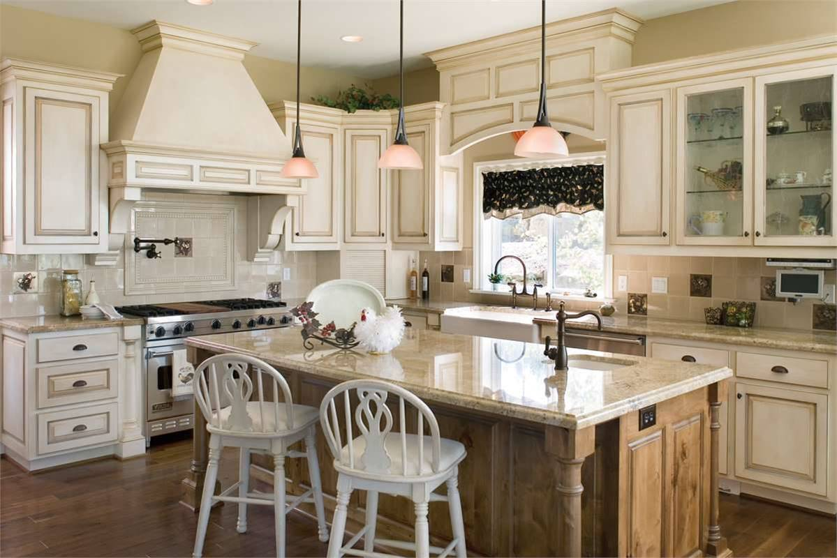 Kitchen with white cabinetry, farmhouse sink, and a breakfast island.
