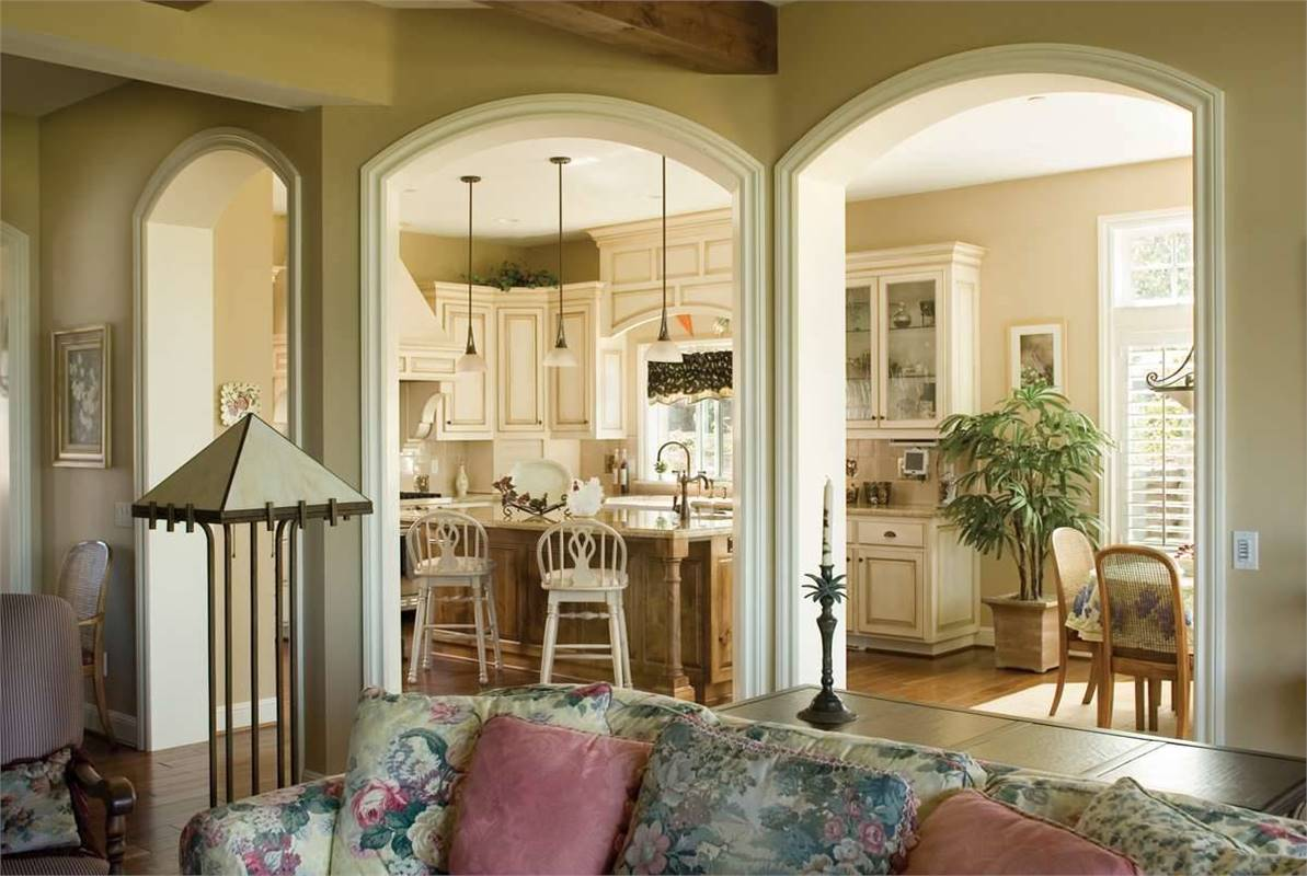 View of the kitchen from the living room showing the open arches.