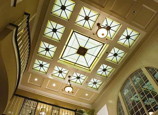 A decorative ceiling fitted with stylish skylights tops the foyer.