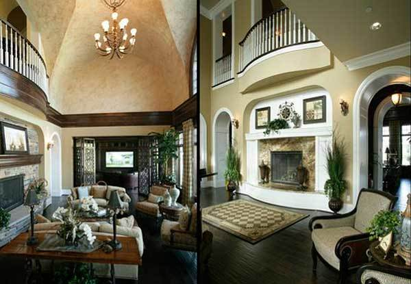 The living room has beige sofas, cushioned armchairs, wooden tables, and a high vaulted ceiling.