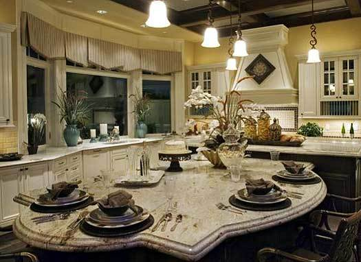 A large eating counter complemented with wooden armchairs is attached to the kitchen island.