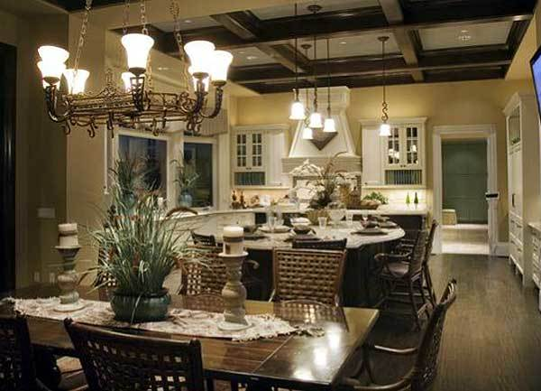 Across the kitchen is a rectangular dining set well-lit by a vintage chandelier.