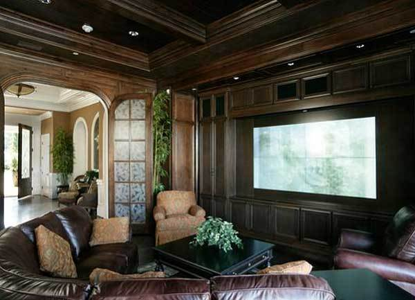 The media room has leather seats wood-paneled walls that match the ceiling.