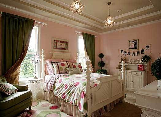Another bedroom with a step ceiling, pink walls, patterned area rug, and white furnishings.