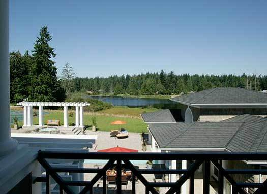 Covered deck overlooking the backyard pool and cabana clubhouse.