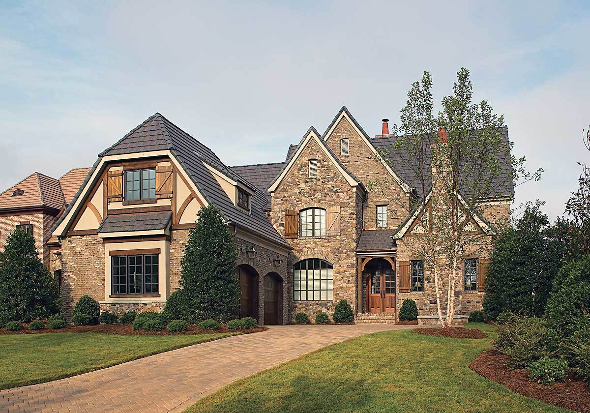 Two-Story 4-Bedroom Ornate Tudor Home with Gambrel Roof
