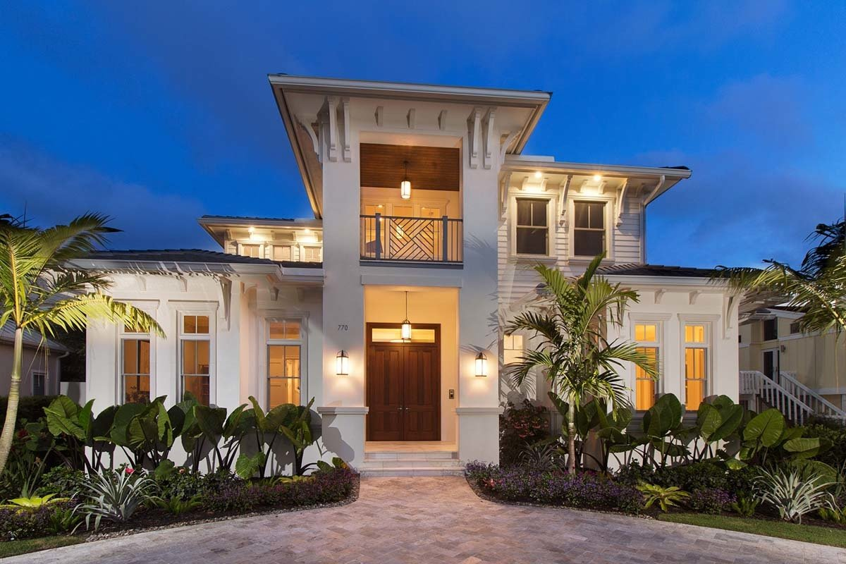 Two-Story 4-Bedroom Southern Home with Elevator and Second-Floor Balconies