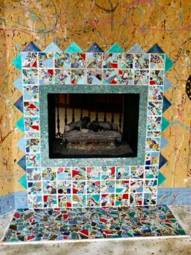 A closer look at the fireplace shows the multicolored surround tiles.