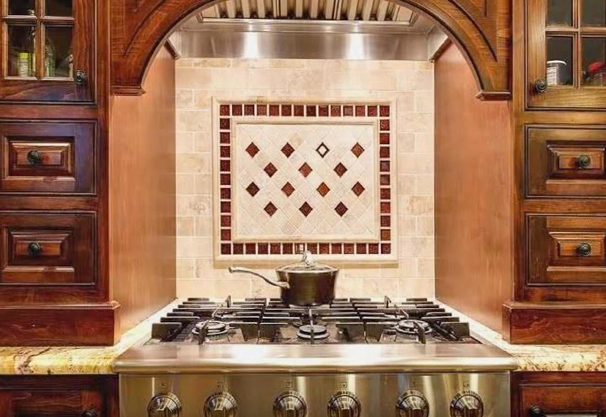 Decorative tile backsplash accentuates the cooking alcove.