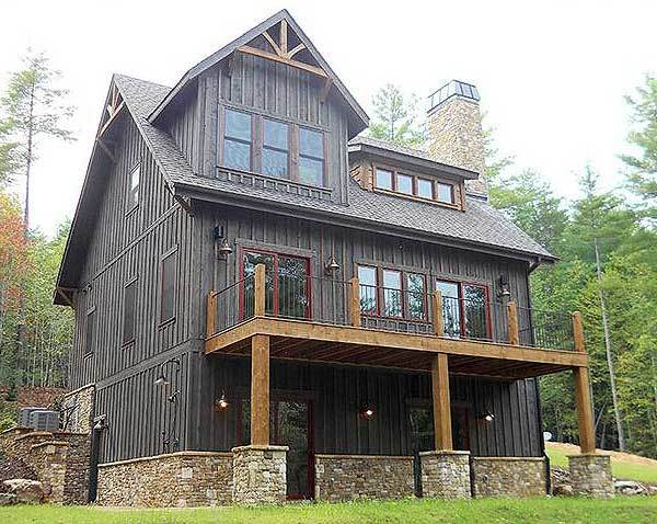 Rear exterior view showing the stone bases and an upper deck supported by wooden columns.