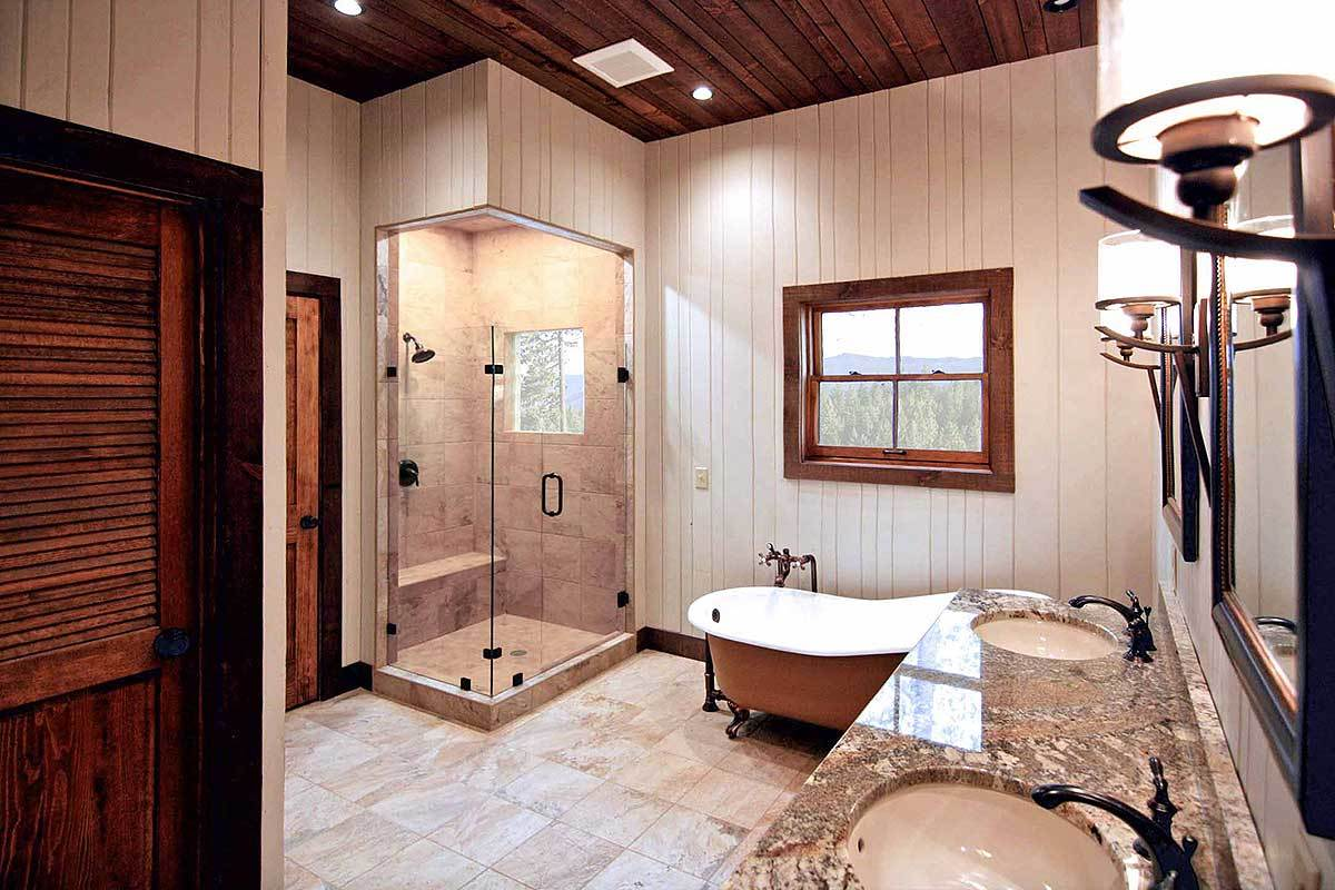 The primary bathroom has a dual sink vanity, a freestanding tub, shower area, and walk-in closet.
