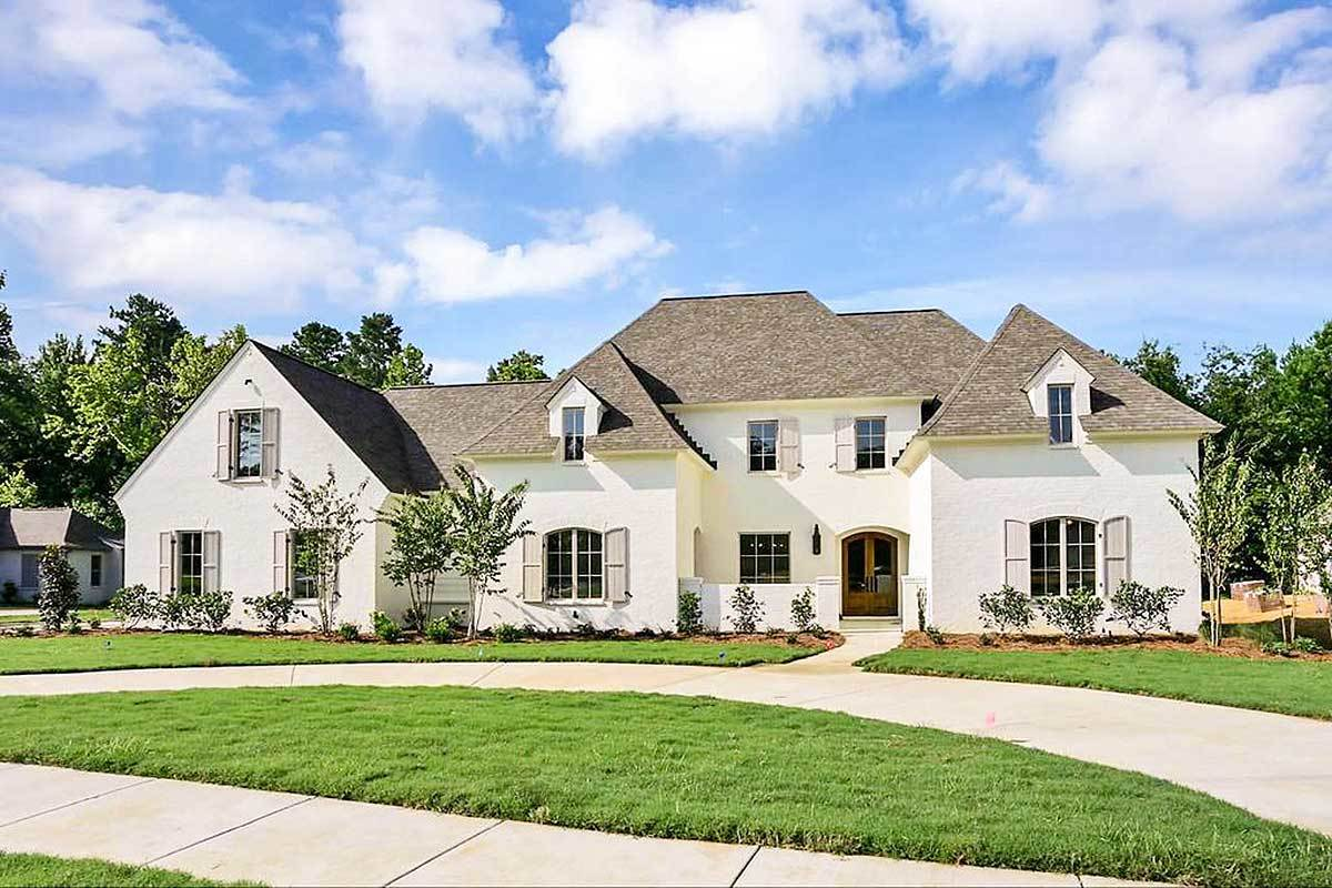 Two-Story 5-Bedroom European Home for Corner Lot with Front Courtyard